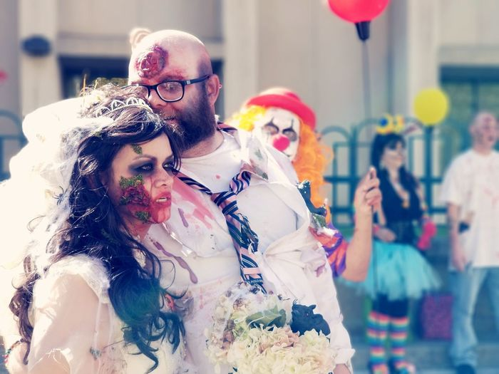 Zombie love with clown photo bomb. Celebration Togetherness Wedding Wedding Dress Bride Two People Love Clown Zombie Denver Colorado  Outdoors Cellphone Photography Conference Mall Crawl Photo Bomb Crazy Moments Memories Moments To Remember  photography #photo #photos #pic #pics #tagsforlikes #picture #pictures #snapshot #art #beautiful #instagood #picoftheday #photooftheday #color #all_shots #exposure #composition #focus capture moment Human Body Part Real People Men Day People