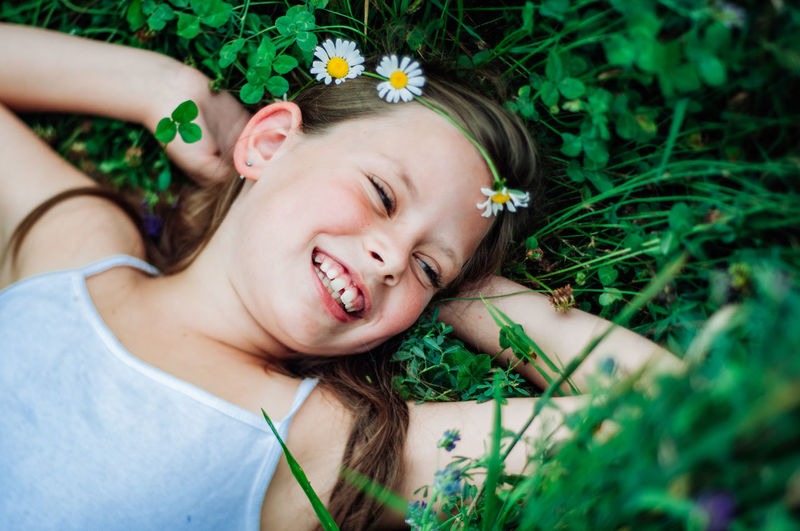 Smiling girl lying on field