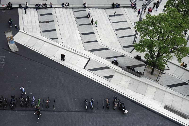 Aerial view of people on road in city