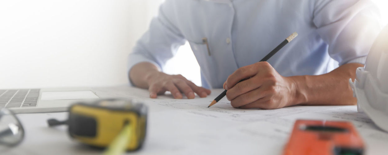Midsection of man working on table