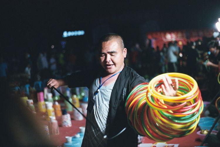 Man performing art at market place