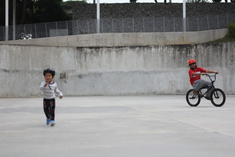 Run Forrest Run! Father And Sons Kid Running Run Run Run Run Running Bmx  Catch The Moment Childhood Cycling Father And Son Happiness Headwear Helmet Kids Wearing Helmet Outdoor Playing Run Forrest, RUN! Son And Daddy Son And Father Toddler Running Togetherness
