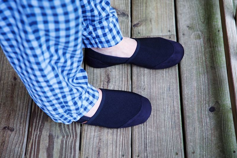 Slippers Low Section Shoe Human Leg One Person Body Part Human Body Part Real People Lifestyles Casual Clothing Wood - Material Flooring Standing Wood Jeans Limb High Angle View Hardwood Floor Leisure Activity Human Limb Human Foot