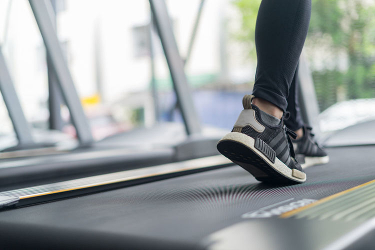 Low section of woman on treadmill