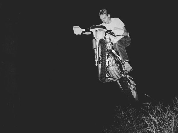 My brother jumping off a dirt mound in the backyard Canonphotography Canonae1 Kodakfilm Slrphotography Blackandwhite Photography Yamaha Dirtbike Riding Freestyle Backintheday