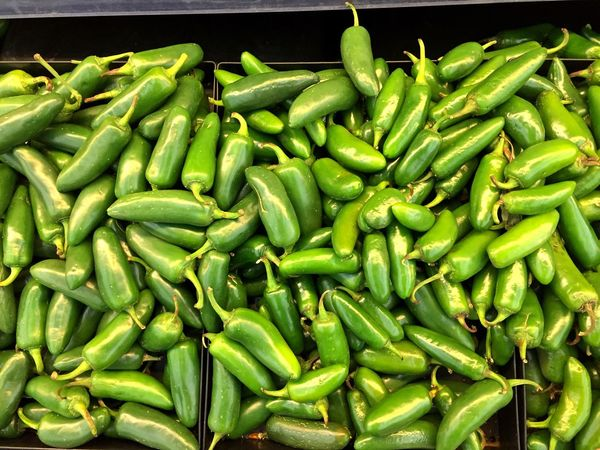 Green Color Food And Drink Abundance Food Freshness Large Group Of Objects Healthy Eating For Sale No People Vegetable Market Retail  Day Outdoors Close-up Jalapeños Texmex Peppers