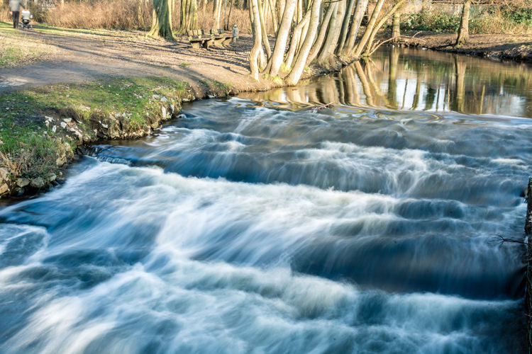Water Beauty In Nature Scenics - Nature Motion River Nature Flowing Water Long Exposure Blurred Motion No People Day Solid Waterfront Rock Flowing Rock - Object Land Forest Outdoors Stream - Flowing Water Power In Nature Purity