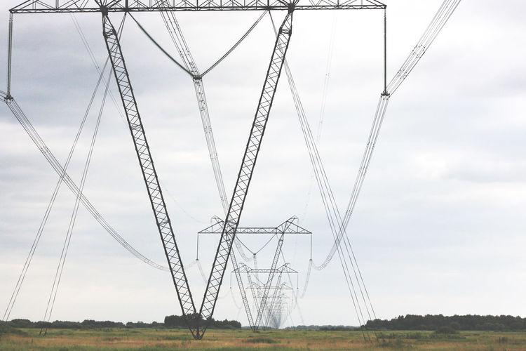 Electricity Pylons On Countryside Landscape