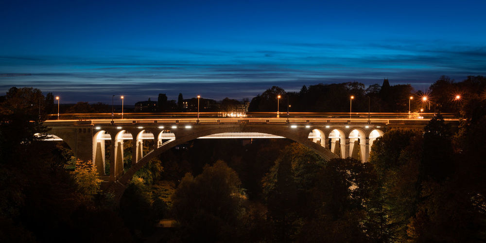 View of illuminated bridge against sky at dusk