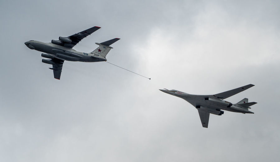 Russia, Moscow, Airshow, victory day, a military parade, refueling in the air, White Swan Air Vehicle Airplane Airshow Blue Cloud Cloud - Sky Cloudy Day Fighter Plane Flying Helicopter Low Angle View Mid-air Military Airplane Mode Of Transport Motion Nature No People On The Move Outdoors Sky