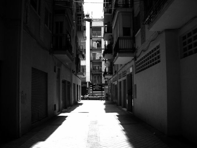 Alley Architecture Black And White Blackandwhite Building Building Exterior Built Structure City Day Direction Empty Footpath House Light And Shadow Monochrome Narrow Nature No People Outdoors Residential District Street Sunlight The Way Forward Transportation