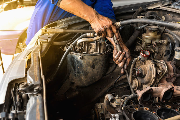 Car overhaul. Car Overhaul Close-up Day Human Body Part Men Occupation One Man Only One Person Only Men People Real People Standing Transportation