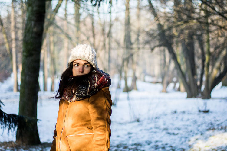 Tree Winter Cold Temperature Snow One Animal Animal Wildlife Outdoors Nature Animals In The Wild Forest Animal Themes Tree Trunk Beauty In Nature Day No People Mammal Uniqueness Looking At Camera Beauty Real People Winter Coat Young Adult Warm Clothing People One Person