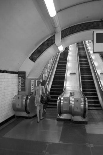 Black And White Photography Convenience Escalator Indoors  London Underground London Underground Escalators Stairs Modern On The Move Person Railing Steps Subway Station Technology The Way Forward Transportation Tube Station  Underground Station  Well-dressed Women