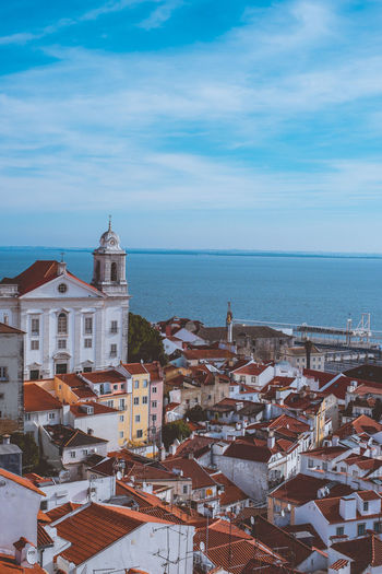 View of Lisbon Alfama district from the top Architecture Built Structure Travel Destinations Lisbon Portugal Europe Building Exterior Building Sky Water Sea City Cloud - Sky Residential District Horizon Over Water High Angle View Horizon Nature No People Roof House Town Cityscape TOWNSCAPE
