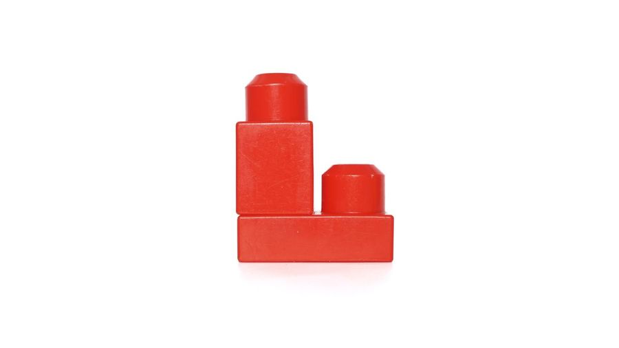 Close-up of red toy against white background