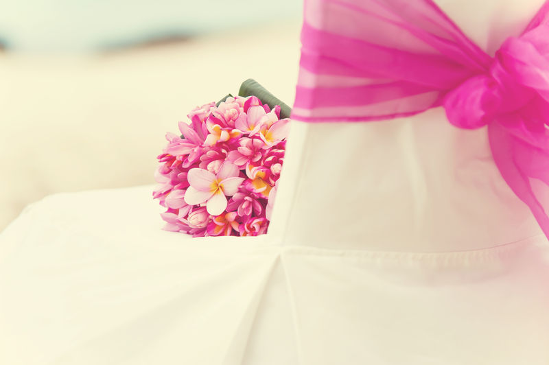 Pink Flowers On Chair At Wedding Ceremony
