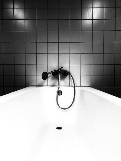 Empty bathtub in bathroom