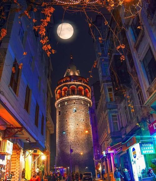 IstanbulArchitecture Illuminated Built Structure Building Exterior Low Angle View Lighting Equipment Night City Travel Destinations Tourism Incidental People City Life Famous Place Tower Arch Decoration Tall - High Spire  Outdoors Skyscraper