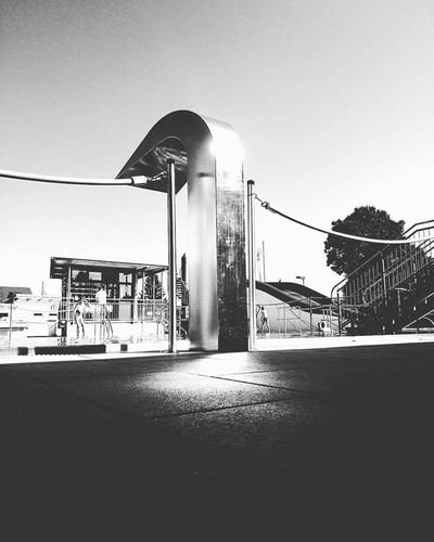 Arched Architecture Blackandwhite Building Exterior Built Structure Cable Clear Sky Day Eye4photography  EyeEm Gallery Gargoyle Hanging Out Lamp Post Long Monochrome No People Outdoorpool Outdoors Power Line  Surface Level Taking Photos Tall