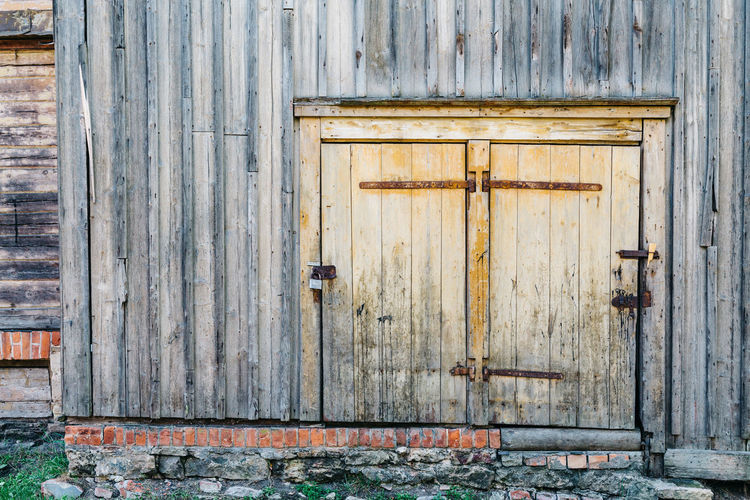 Architecture Building Building Exterior Built Structure Closed Day Door Entrance Full Frame House Latch Lock No People Old Outdoors Protection Safety Security Weathered Wood - Material