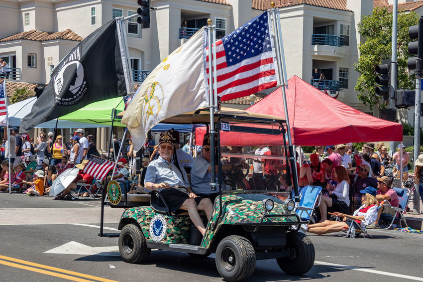 shriners driving in little cars in the Huntington Beach 4th of July parade 4th Of July Parade American Patriotic Crowd Day Editorial Use Only Group Of People Holding Independence Day Main Street Men Mode Of Transportation Orange County Outdoors Parade Real People Shriners Shrinershospital Small Cars Southern California Life Transportation