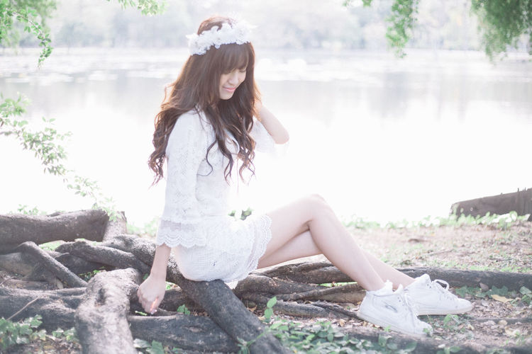 Beauty in white dress One Person Leisure Activity Real People Casual Clothing Full Length Lifestyles Day Hairstyle Nature Sitting Young Adult Long Hair Young Women Women Hair Beautiful Woman Land Focus On Foreground Fashion Outdoors Teenager