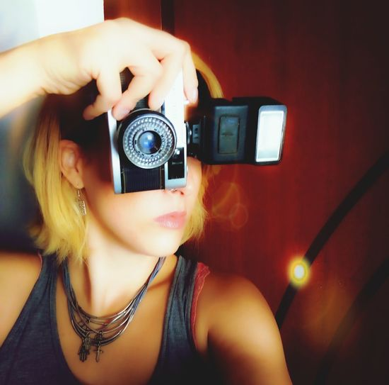Close-up of woman photographing with camera