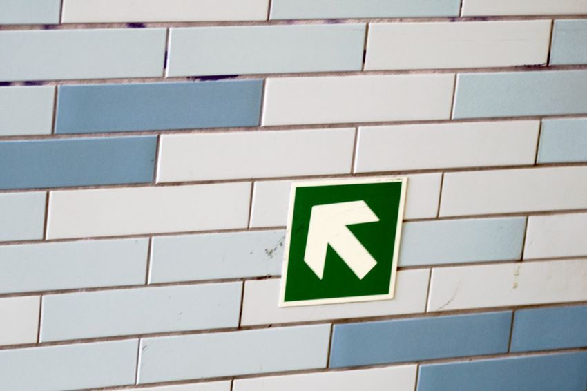 Arrow Symbol Close-up Communication Day Direction Green Color Guidance No People Wall Tiles Way Up