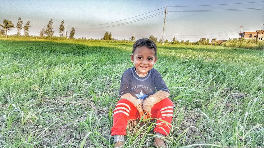 Beautiful boy and beautiful smile in the countaryside ... Smile Beautiful Beautful Day BeautifulBoy BeautifulSmile Snapseed Looking At Camera Sky Smartphone Galaxy Note 5 Samsung Galaxy Note 5 Egypt Samsung Galaxy Camera Alexandria Egypt Landscape