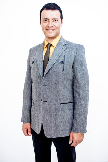 Man in classic suit on the white background. Studio shot. Business Business Stories Suit Business Business Finance And Industry Business Person Businessman Formalwear Front View Happiness Indoors  Looking At Camera Males  Men Menswear One Person Portrait Smiling Standing Studio Shot Suit Three Quarter Length Well-dressed White Background Young Adult