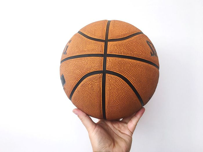 smile or not to smile? EyeEm Selects Human Hand Ball Human Body Part Hand Sport Basketball - Sport Studio Shot White Background Holding One Person Close-up Cut Out Personal Perspective Orange Color Basketball - Ball Finger Single Object Lifestyles