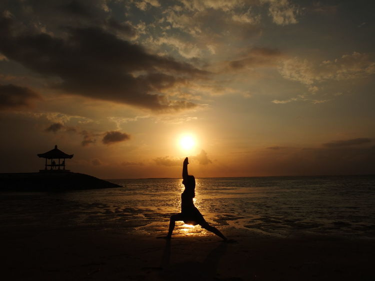 Warrior oneBali Sanur Yoga Yoga Pose Beach Beauty In Nature Cloud - Sky Horizon Over Water Leisure Activity Nature One Person Outdoors People Scenics Sea Silhouette Sky Sun Sunrise Tranquil Scene Tranquility Virabhadrasana Warrior Pose Water Women Mix Yourself A Good Time