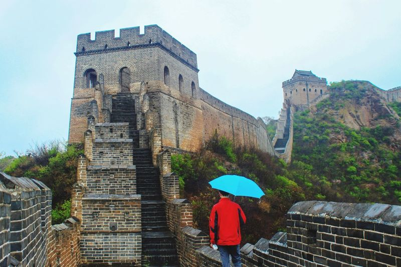 Umbrella Great Wall Of China Built Structure Architecture Building Exterior Building Sky Real People Nature Day Tree Plant City Lifestyles Travel Destinations History Adult Outdoors Men Travel The Past