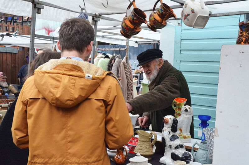 Day Flower For Sale Hackney London Market Market Market Stall Men Only Men Outdoors People Retail  Retail Place Saturday Shop Store Street Market Two People Vintage