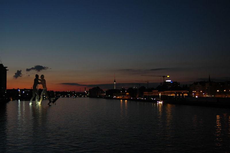 Molecule Man Sculpture On Spree River At Sunset
