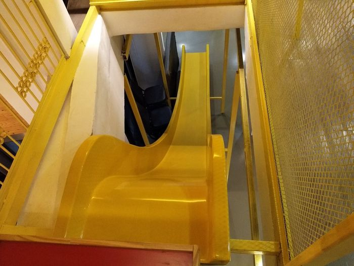 Close-up of yellow staircase in playground