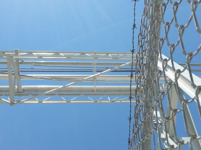 May theme Looking Up Low Angle View Directly Overhead Rails Fence Metal Blue Day Sky Electricity  Clear Sky No People Outdoors Technology Close-up Blue Sky The Architect - 2017 EyeEm Awards The EyeEm Collection Investing In Quality Of Life The Premium Collection