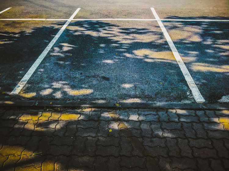 Change City Day Direction Dividing Line Footpath Guidance High Angle View Leaf Marking Nature No People Outdoors Pattern Paving Stone Plant Part Road Road Marking Sign Street Symbol Transportation Yellow