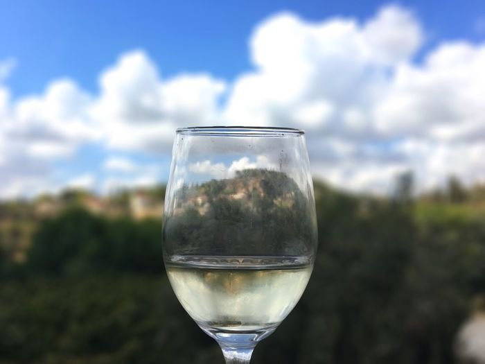 Drink Refreshment Focus On Foreground Glass - Material Food And Drink Close-up Transparent Freshness Reflection Sky Water Day Growth Summer Indulgence Purity Cloud - Sky No People Scenics Tranquility Winery Wine Wine Tasting TakeoverContrast