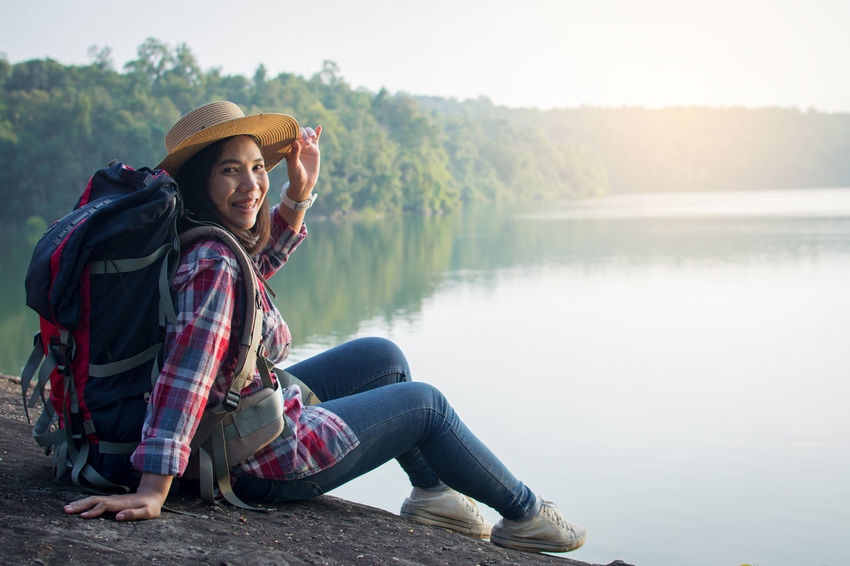 Hat Lake Lifestyles Nature One Person Outdoors Sitting Water Young Adult Young Women