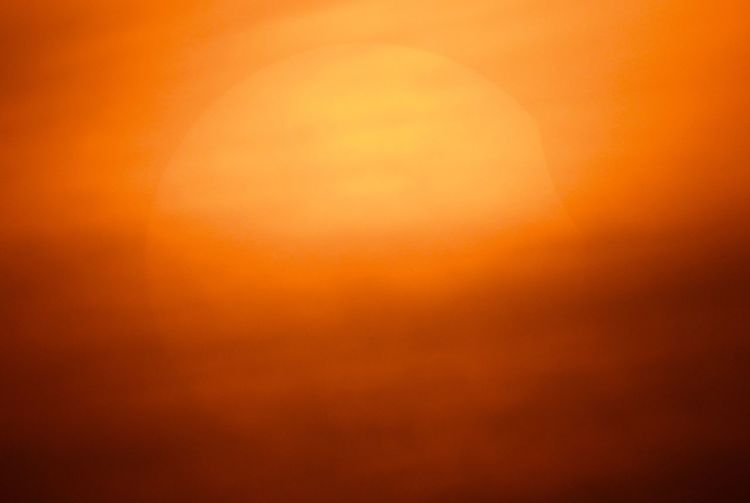 A partial eclipse is behind the clouds Orange Color Backgrounds No People Yellow Gold Colored Sunset Sky Abstract Beauty In Nature Scenics - Nature Full Frame Nature Tranquility Vibrant Color Abstract Backgrounds Tranquil Scene Colored Background Textured  Idyllic Outdoors