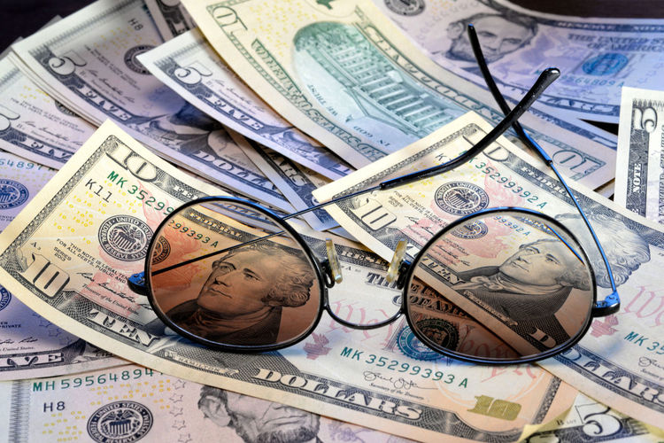 Sunglasses is placed on the banknote of US dollars spread around Dollar Money Cash Savings Banking Finance Bill Currency Wealth Background Banknote Bussiness Profit Green Close-up USD Exchange Loan  Paper Sign Payment Pay Stack Number Textured  Abstract Earnings Symbol Capital Assets Sunglasses Face President Business Paper Currency Studio Shot Large Group Of Objects Indoors  No People Exchange Rate Human Representation Corporate Business Backgrounds Male Likeness Representation