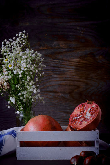 Autumn Fruits, Pomegranate and Chestnuts Chestnuts Beauty In Nature Close-up Day Flower Flowering Plant Food Food And Drink Freshness Fruit Healthy Eating Nature No People Outdoors Plant Pomegranate Still Life Sunlight Water Wellbeing Wood - Material
