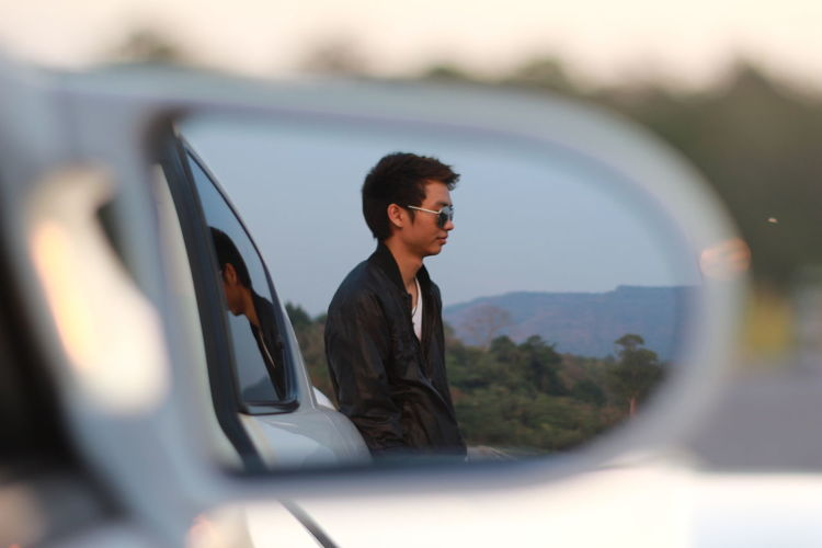 Reflection of man on mirror in car mazsa rx-8