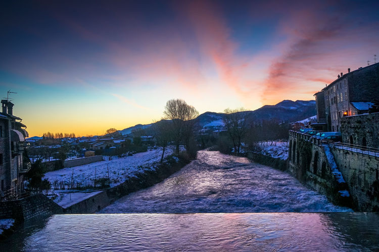 Sky Architecture Snow Winter Sunset Cold Temperature Built Structure Nature Building Exterior Beauty In Nature Cloud - Sky Scenics - Nature No People Water Direction Tranquility Mountain Tranquil Scene Outdoors Canal