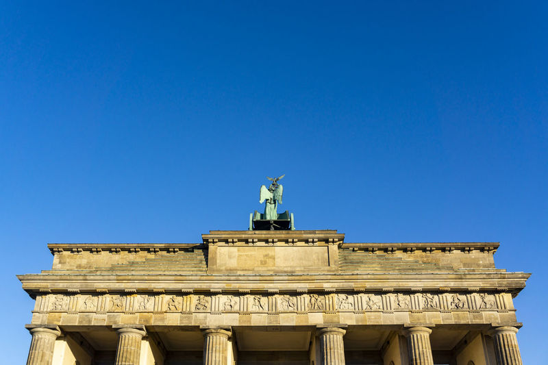 Back of Brandenburg Gate with Quadriga Against Clear Sky Berlin Germany 🇩🇪 Deutschland Color Image Outdoors No People Brandenburg Gate Quadriga Clear Sky Architecture History Built Structure Famous Place Memorial Art And Craft Blue Low Angle View The Past Building Exterior Statue Sculpture Back