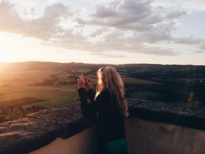 Beauty In Nature Bonding Camera - Photographic Equipment Cloud - Sky Day Friendship Landscape Leisure Activity Lifestyles Nature Outdoors People Photographing Photography Themes Real People Scenics Selfie Sky Standing Togetherness Two People Water Women Young Adult Young Women