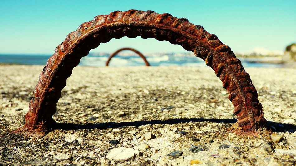Near the Sea an Old Rusty Iron Hanging Out Outdoors Day Blue Close Up Photography Close-up Sky Iron Rusty Rusty Metal Seaside EyeEm Gallery Taking Photos