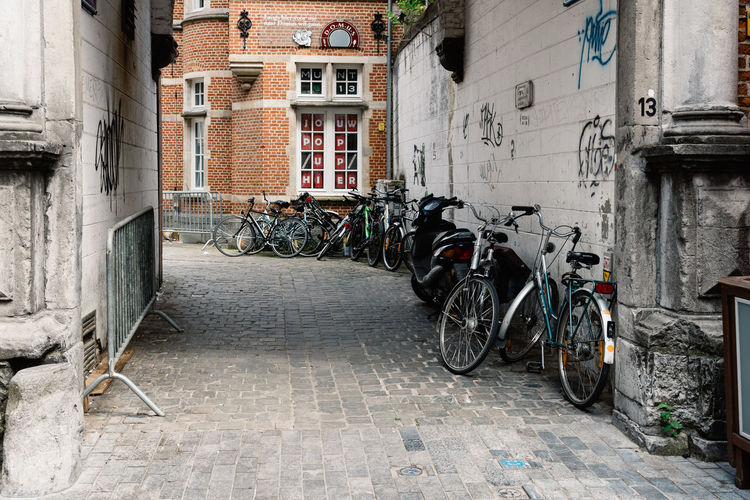 Bicycles parked in empty street of Leuven Alletattoo Architecture Bicycle Building Exterior Built Structure City City City Life Cityscape Day Destination Empty Land Vehicle Leuven Mode Of Transport No People Outdoors Parking Stationary Student Life Students Tower Tranquility Transportation Window